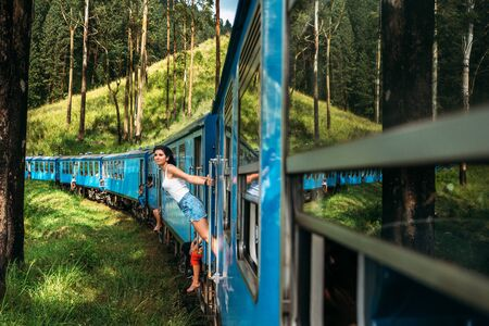 Travel by train. The girl travels by train to beautiful places. Beautiful girl traveling by train among mountains. Travel the world. Trains Sri Lanka. Railway transport. Railway. Transport Asia