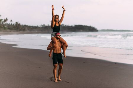 Happy couple on vacation. Lovers on the coast. Man and woman are resting on the sea. Beautiful couple have fun at the sea. Vacation at sea. Vacation on the island of Bali. Travel to Asia