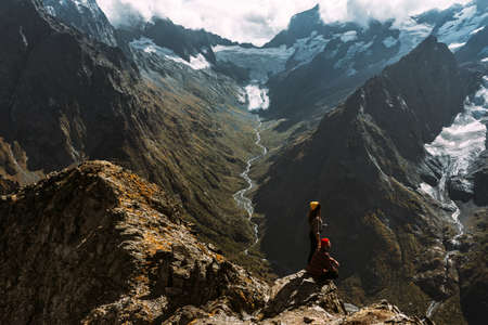 The couple travels through the Caucasus mountains. Couple in love in the Caucasus mountains. Man and woman traveling. A walk in the mountains. Hiking in the mountains. Panorama. Copy space Reklamní fotografie