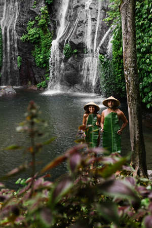 Couple among the greenery. A couple in love in the tropics. The couple is traveling in Asia. Beautiful couple traveling on the island of Bali. A man and a woman against the background of nature 版權商用圖片