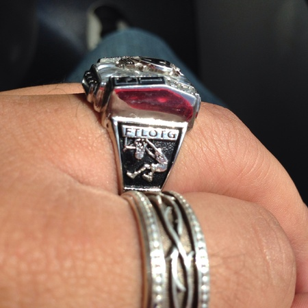 Class ring with the acronym for For The Love Of The Game.