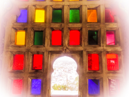 Colorful glass royal ancient windows in Rajasthan architecture Stock Photo