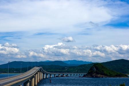Sea and bridge of summer Stock Photo - 16758579