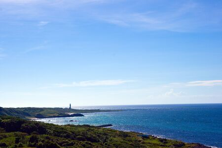 The lighthouse which is visible in the distance