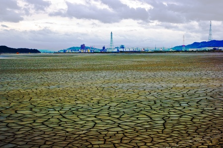 The dry earth and factory Standard-Bild