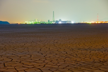factory and cracked clay ground into the dry