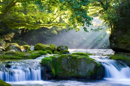 beauty spot: Mountain stream and shaft beam of light