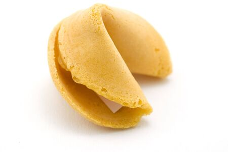 Close up side view of single fortune cookie and white background photo