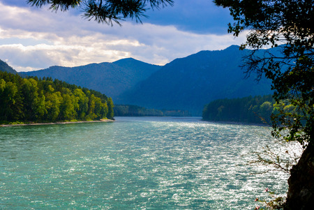 katun: View of the wide blue river and the blue mountains.