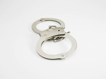 constraints: Handcuffs isolated on white