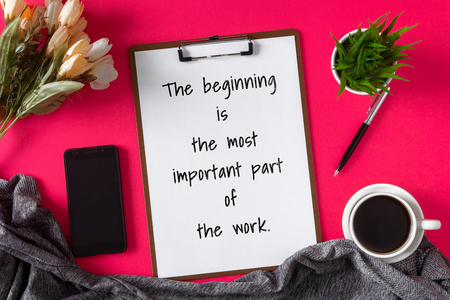 Inspirational and motivation life quote on clipboard with paper - The beginning is the most important part of the work.