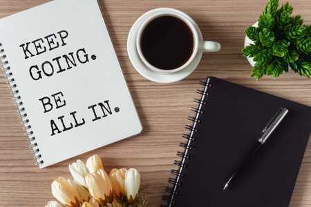 Inspirational and motivation life quote on notepad - Keep going, be all in.