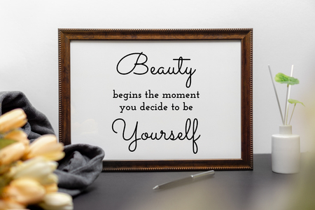 Inspirational and motivation beauty and life quote on wood frame - Beauty Begins the Moment You Decide to be Yourself. Archivio Fotografico