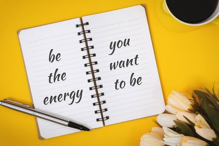 Motivational and Inspirational Quotes. Be The Energy You Want To Be. Still Life of Notebook on Work Desk. Banco de Imagens
