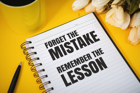 Motivational and Inspirational Quotes. Forget The Mistake, Remember The Lesson. Still Life of Notebook on Work Desk. Banco de Imagens