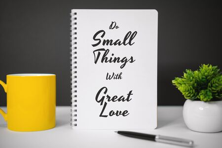 Motivational and Inspirational Quotes. Do Small Things With Great Love. Still Life of Notebook on Work Desk.