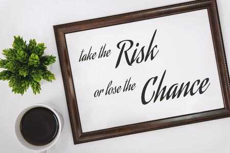 Motivational and Inspirational Quotes. Take The Risk or Lose The Chance. Still Life of Word Frame on Work Desk. Banco de Imagens