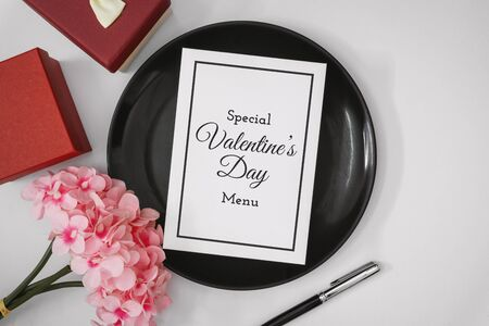 Special Valentine's Day Menu. Paper Card on Plate with Copy Space. Love and Romance Concept.