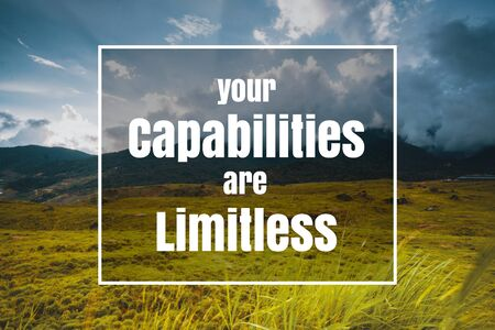 Inspirational and Motivational Quote. Your Capabilities are Limitless. Grass Against Sky Background. Banco de Imagens