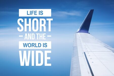 Travel, Adventure and Exploration Quote. Life is Short and The World is Wide. Airplane Wings Against Blue Sky. Banco de Imagens