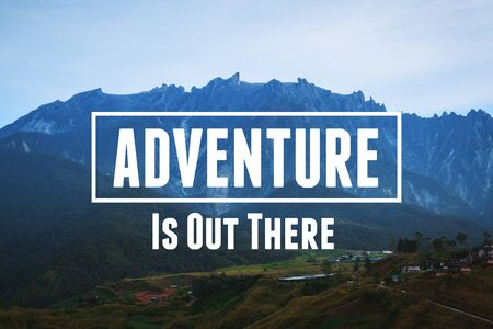 Inspirational and Motivational Quote. Adventure is Out There. Mountain Against Sky Background.