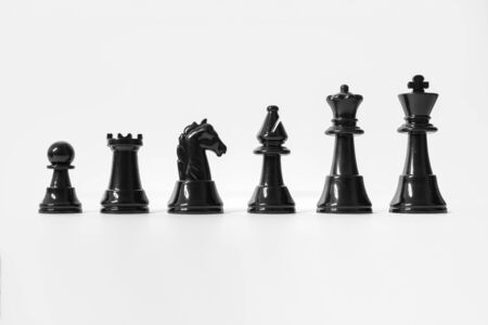 Chess Set. Black Chess Pieces Isolated on White Background. Chess Concepts. Banco de Imagens