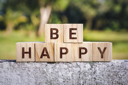 Wooden Block With The Phrase Be Happy