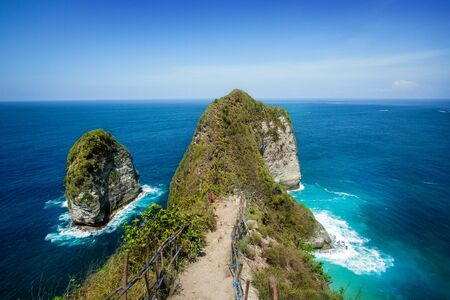 Kelingking BeachT-Rex Bay Against Sea Horizon at Nusa Penida Island, Bali, Indonesia
