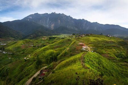 Farming village and Mount Kinabalu view from Sosodikon Hill. Kundasang Sabah.