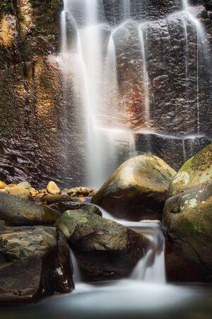 Serene Water Flows Down The Cascade Waterfall