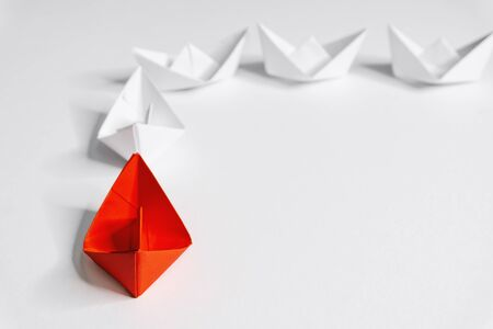 Business and Leadership. Unique Paper Boat Leading The Rest By Example.
