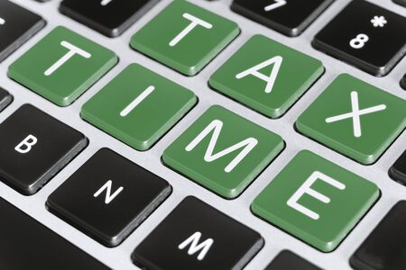 Tax Filing Concept. Tax Time on Computer Keyboard