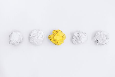 Unique Yellow Crumple Paper In Line With Others. Business Concept.