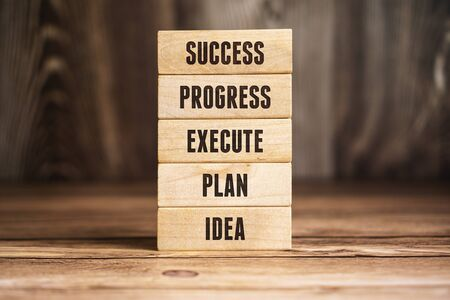 Wooden Block Ladder of Success. Business and Career Progress Concept.