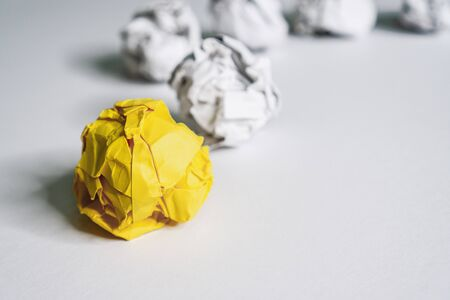 Unique Yellow Crumple Paper leading the rest. Business and Leadership Concept.
