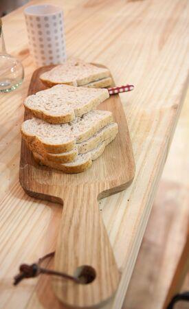 multi grain sandwich: Wholewheat bread on wood cutter