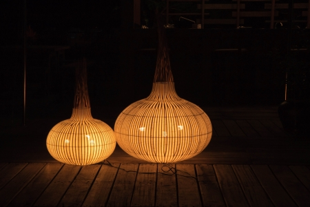 Modern garlic shape lantern light glowing in dark photo