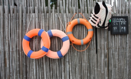 floatable: Orange foam rings hangs on the bamboo wall