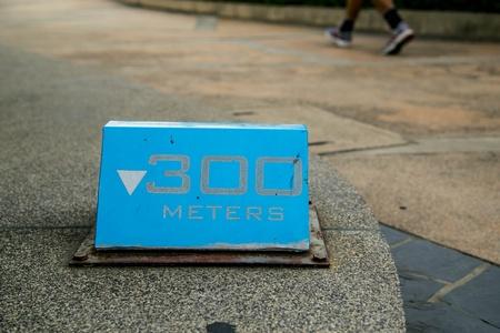 kilometres: blue running sign