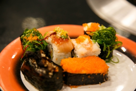 Assorted Sushi on orange plate photo