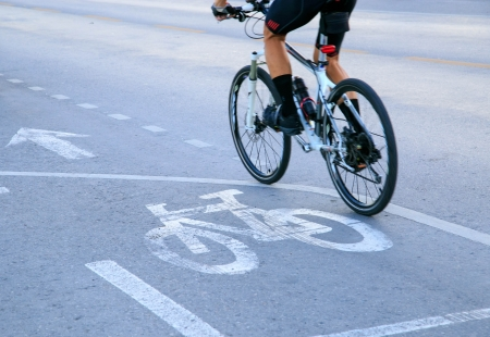 white bicycle sign on asphalt street