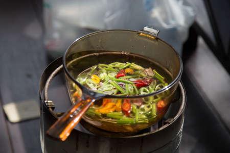 Thai herbs in transparant boiling pan photo