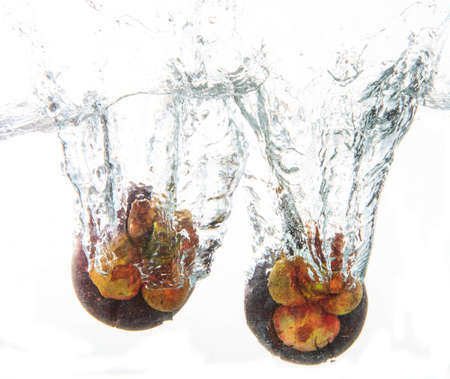 mangosteens in clear water
