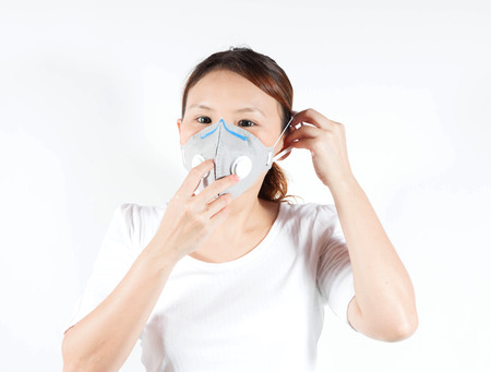 Woman in white shirt with pollution mask photo