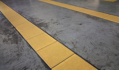 yellow lines on glossy concrete floor photo