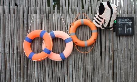 floatable: Orange foam rings hangs on the bamboo wall