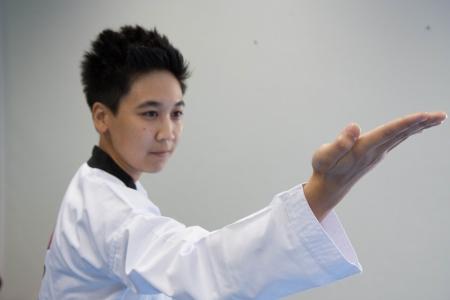 clasp feet: Taekwondo training Stock Photo