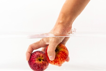 Red apples in clear water Stock Photo
