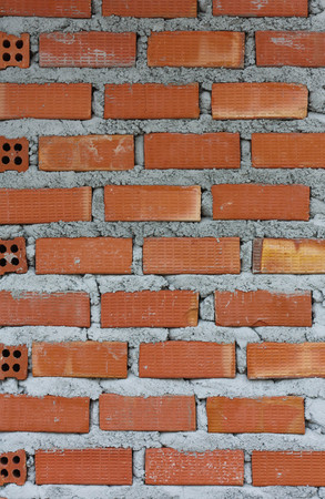brown bricks and concrete wall photo