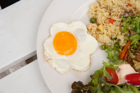 Breakfast plate with nice fried egg Stock Photo